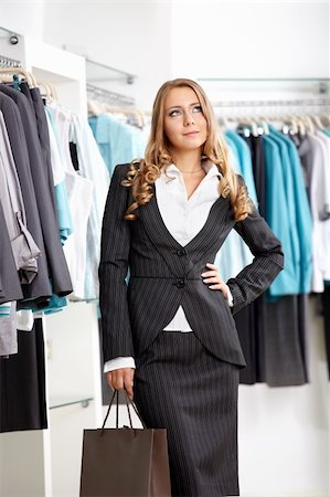 The nice young girl in clothes shop Stock Photo - Budget Royalty-Free & Subscription, Code: 400-04271044