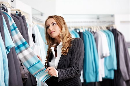 The attractive girl considers clothes in shop Stock Photo - Budget Royalty-Free & Subscription, Code: 400-04271045
