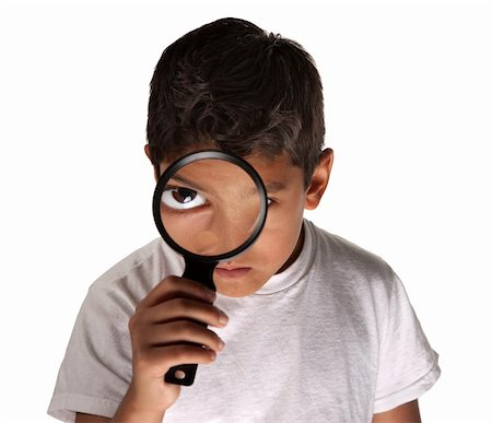 Young Latino boy looking through a magnifying glass on white background Stock Photo - Budget Royalty-Free & Subscription, Code: 400-04284695