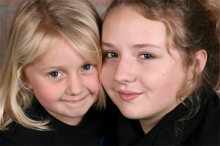 Two beautiful blond sisters holding one another close Stock Photo - Budget Royalty-Free & Subscription, Code: 400-04283914
