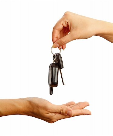 finger holding a key - Female hand holding a car key on white background Stock Photo - Budget Royalty-Free & Subscription, Code: 400-04296964