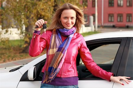 Beautiful young happy woman with car keys Stock Photo - Budget Royalty-Free & Subscription, Code: 400-04297879