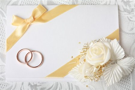 Wedding invitation card with gold rings and satin rose Stock Photo - Budget Royalty-Free & Subscription, Code: 400-04298672
