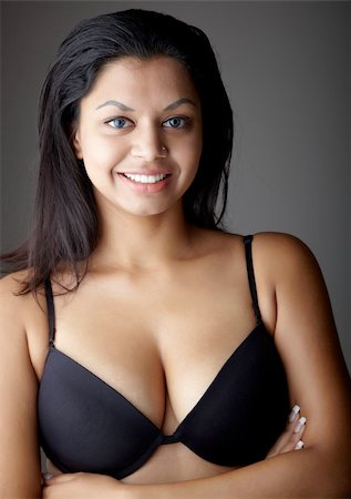 Young voluptuous Indian adult woman with long black hair wearing black lingerie and blue coloured contact lenses on a neutral grey background. Mixed ethnicity Stock Photo - Budget Royalty-Free & Subscription, Code: 400-04298931