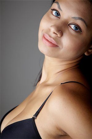 female naked large breasts or boobs - Young voluptuous Indian adult woman with long black hair wearing black lingerie and blue coloured contact lenses on a neutral grey background. Mixed ethnicity Stock Photo - Budget Royalty-Free & Subscription, Code: 400-04298933