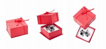 silver box - Earring in red present box isolated on white Stock Photo - Budget Royalty-Free & Subscription, Code: 400-04290050