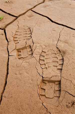 Boot footprints in dry cracked earth Stock Photo - Budget Royalty-Free & Subscription, Code: 400-04304444