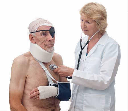 A woman doctor is using a stethoscope to listen to an old-man's heart. He has been badly injured in an accident. Isolated on white. Stock Photo - Budget Royalty-Free & Subscription, Code: 400-04306104