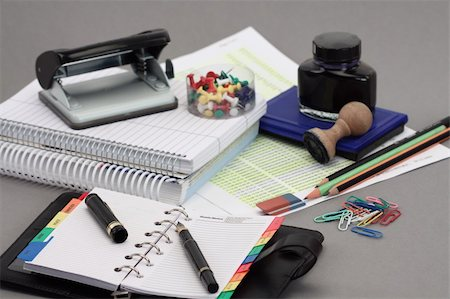 Office stationery over gray background Stock Photo - Budget Royalty-Free & Subscription, Code: 400-04309380