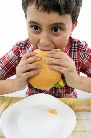 boy eating a big hamburger close up Stock Photo - Budget Royalty-Free & Subscription, Code: 400-04309383