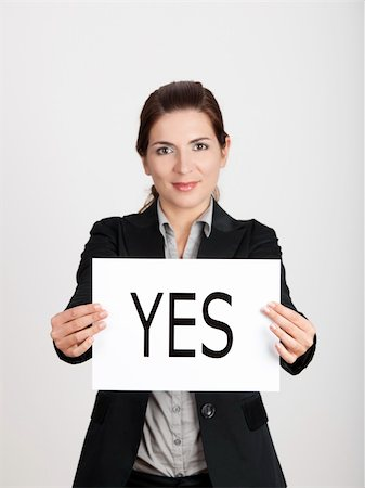 Business young woman showing a paper card with the word YES Stock Photo - Budget Royalty-Free & Subscription, Code: 400-04309540
