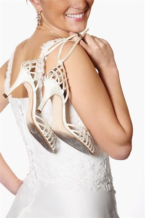 A picture of a bride and her worn-out shoes after the wedding party Stock Photo - Budget Royalty-Free & Subscription, Code: 400-04300759