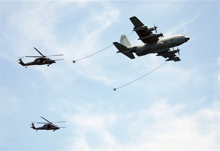 US Army aerial refueling operation with tanker plane and helicopters Stock Photo - Budget Royalty-Free & Subscription, Code: 400-04317893