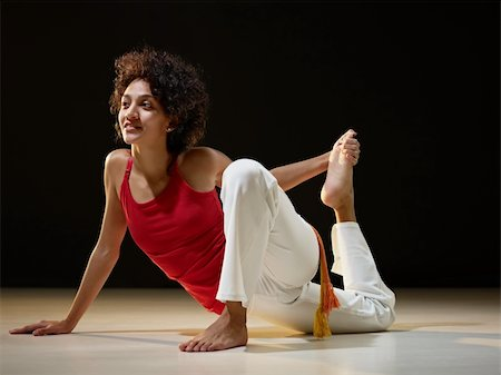 feet gymnast - portrait of young adult latin american female doing yoga exercise in gym. Horizontal shape, full length, side view, copy space Stock Photo - Budget Royalty-Free & Subscription, Code: 400-04318322