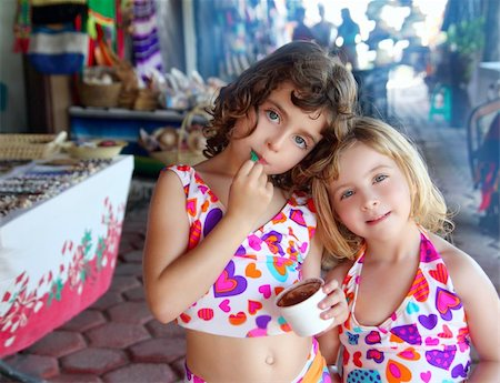 beautiful sisters  little girls eating chocolate ice cream in mexican market Stock Photo - Budget Royalty-Free & Subscription, Code: 400-04319298