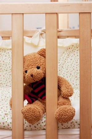 simsearch:400-04598294,k - Fluffy teddy bear sitting on a cot and waiting. Stock Photo - Budget Royalty-Free & Subscription, Code: 400-04310488