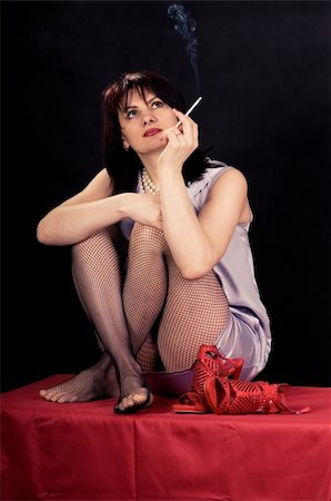stocking feet - girl with a cigarette thoughtfully looking up Stock Photo - Budget Royalty-Free & Subscription, Code: 400-04312595