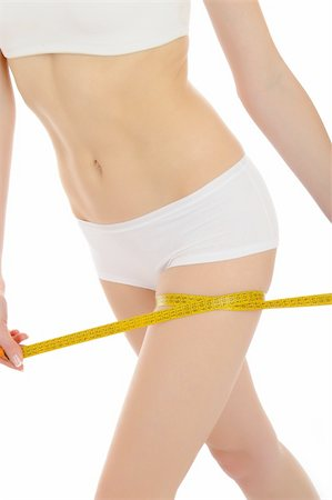 Part of beautiful fit slim woman body in white underwear measuring legs. anti-cellulite. isolated Stock Photo - Budget Royalty-Free & Subscription, Code: 400-04312768