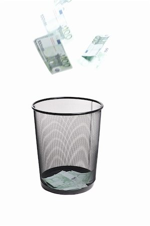 money flying into the trash isolated on white Stock Photo - Budget Royalty-Free & Subscription, Code: 400-04324985