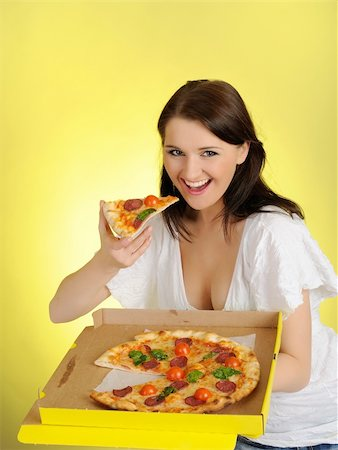 fat italian woman - Pretty young casual girl with tasty pizza in delivery paper box. isolated on yellow background Stock Photo - Budget Royalty-Free & Subscription, Code: 400-04326264