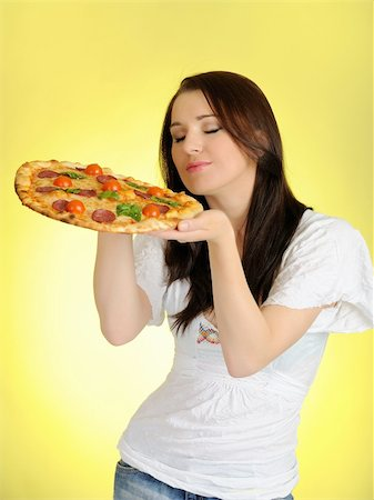 fat italian woman - Pretty young casual girl with tasty pizza in delivery paper box. isolated on yellow background Stock Photo - Budget Royalty-Free & Subscription, Code: 400-04326440