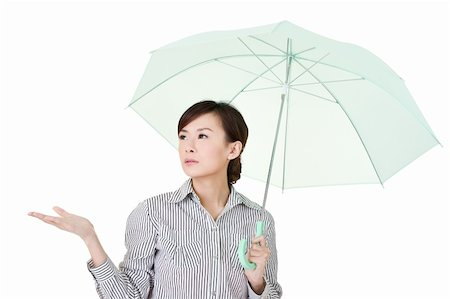 Business woman holding umbrella of green, closeup portrait on white background. Stock Photo - Budget Royalty-Free & Subscription, Code: 400-04327645