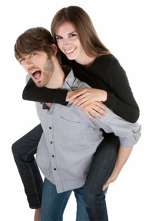 Young handsome man carries a cute lady on his back Stock Photo - Budget Royalty-Free & Subscription, Code: 400-04328074