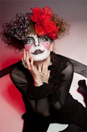 Woman mime with theatrical makeup. Studio shot. Stock Photo - Budget Royalty-Free & Subscription, Code: 400-04329092