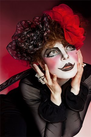 Woman mime with theatrical makeup. Studio shot. Stock Photo - Budget Royalty-Free & Subscription, Code: 400-04329093