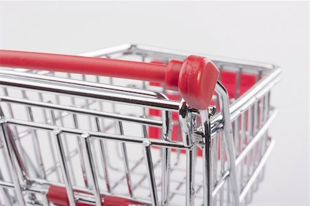 empty shopping cart - Empty shopping cart with the red handle on a white background. Stock Photo - Budget Royalty-Free & Subscription, Code: 400-04321973