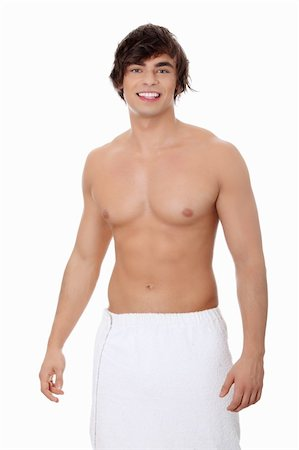 Handsome, happy young man with the towel around his waist. Isolated on white Stock Photo - Budget Royalty-Free & Subscription, Code: 400-04335241