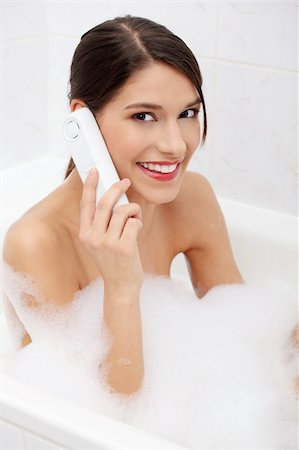Beautiful young woman talking by wireless phone while taking a bath Stock Photo - Budget Royalty-Free & Subscription, Code: 400-04336006