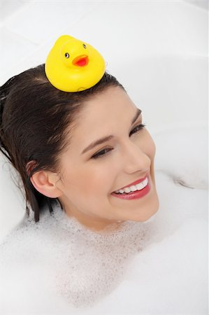 Beautiful young caucasian woman taking a bath with yellow duck. Stock Photo - Budget Royalty-Free & Subscription, Code: 400-04336010