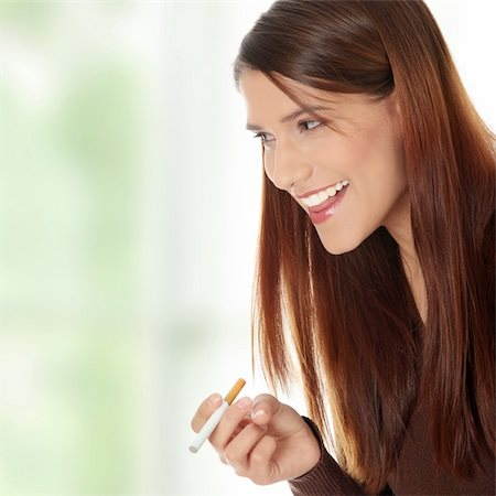Young woman smoking electronic cigarette (ecigarette) Stock Photo - Budget Royalty-Free & Subscription, Code: 400-04336168