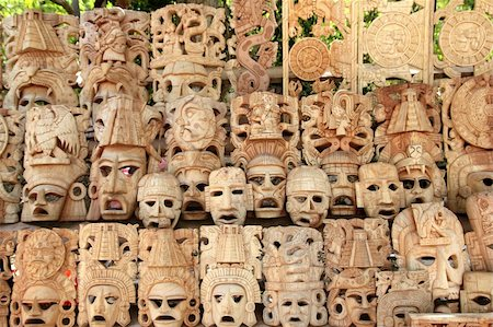 Mayan wood mask rows Mexico handcraft faces indian culture Stock Photo - Budget Royalty-Free & Subscription, Code: 400-04337031