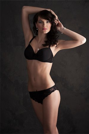 Glamorous sexy standing woman in black lingerie on dark background Stock Photo - Budget Royalty-Free & Subscription, Code: 400-04339551
