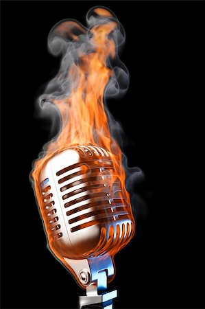 old mic in flames. isolated on black. Stock Photo - Budget Royalty-Free & Subscription, Code: 400-04331053