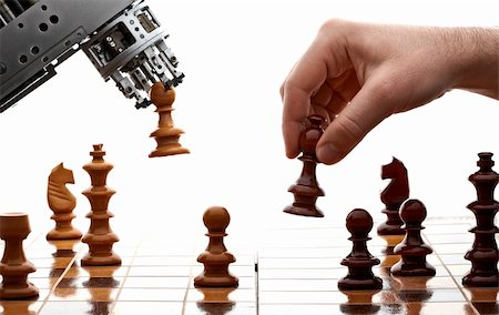 human playing chess with a machine Stock Photo - Budget Royalty-Free & Subscription, Code: 400-04332154