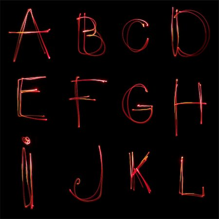 Neon alphabet on  black background Stock Photo - Budget Royalty-Free & Subscription, Code: 400-04344797