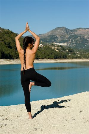 Early morning yoga at a scenic lakeside setting Stock Photo - Budget Royalty-Free & Subscription, Code: 400-04345370