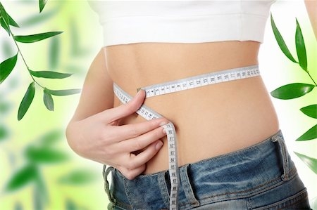 Sexy, fit, young woman measuring her waist Stock Photo - Budget Royalty-Free & Subscription, Code: 400-04345877