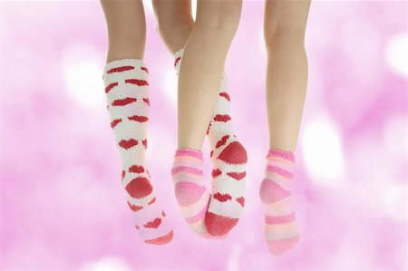stocking feet - Four crossed legs with colorful socks - friendship or love concept Stock Photo - Budget Royalty-Free & Subscription, Code: 400-04345886