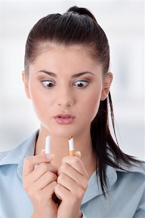 Young woman breaking cigarette Stock Photo - Budget Royalty-Free & Subscription, Code: 400-04346742