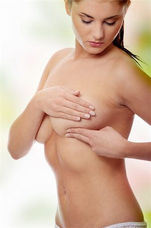Breast cancer - Woman holding her breast Stock Photo - Budget Royalty-Free & Subscription, Code: 400-04346750