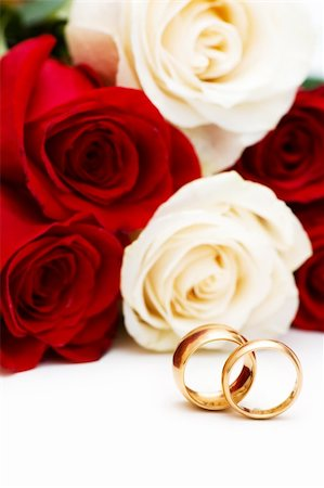 Roses and wedding rings isolated on the white Stock Photo - Budget Royalty-Free & Subscription, Code: 400-04341521