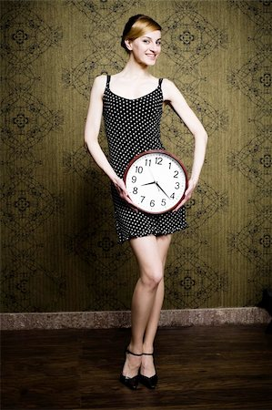 An image of a nice girl holding a big white clock Stock Photo - Budget Royalty-Free & Subscription, Code: 400-04354040
