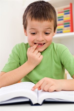 Stressed elementary school boy with reading problems trying to remember Stock Photo - Budget Royalty-Free & Subscription, Code: 400-04355015
