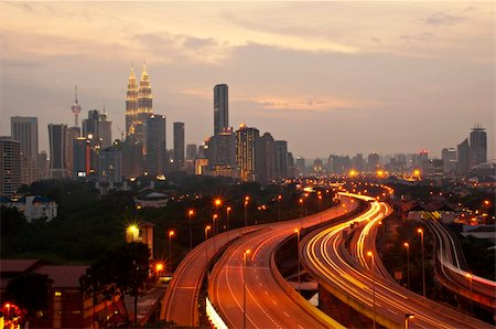 This scenario Kuala Lumpur twin towers, taken with slow shutter speed to get the light trail from the highway traffic in the evening. Stock Photo - Budget Royalty-Free & Subscription, Code: 400-04355434
