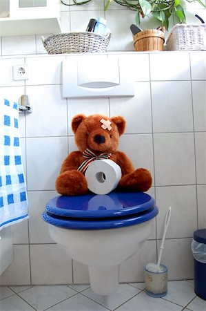 toy teddy bear with paper in the bathroom on toilet Stock Photo - Budget Royalty-Free & Subscription, Code: 400-04355734