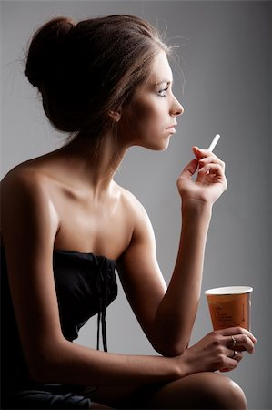 Portrait of elegant female smoking with plastic glass in hand Stock Photo - Budget Royalty-Free & Subscription, Code: 400-04357071